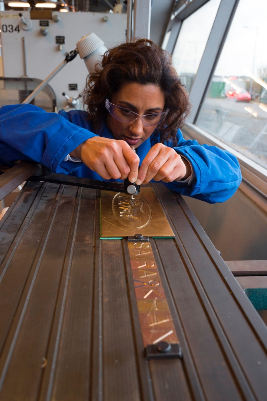 Saira Khan tries her hand at engraving on a pantographic machine